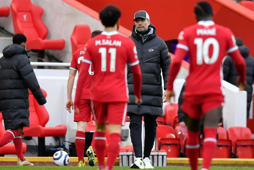 Reaksi pelatih Liverpool Jurgen Klopp usai dikalahkan Fulham di Anfield, Ahad (7/3).