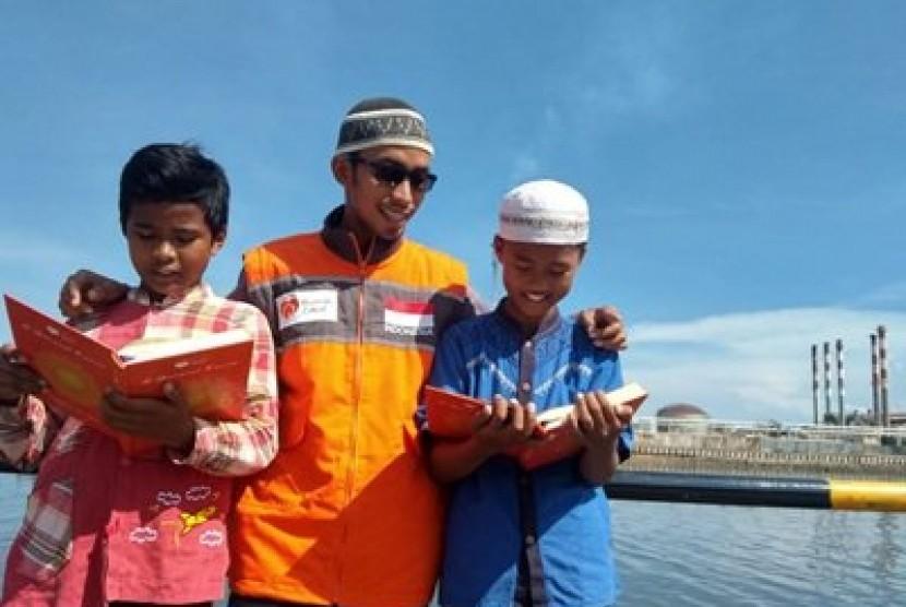 Relawan Rumah Zakat Balikpapan kembali membagikan paket Ramadhan Syiar Quran.