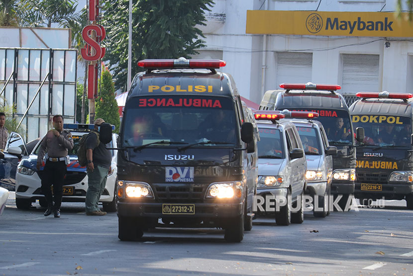 Ambulances carry bomb blast victims out of Surabaya police headquarters, East Java, on Monday (May 14).