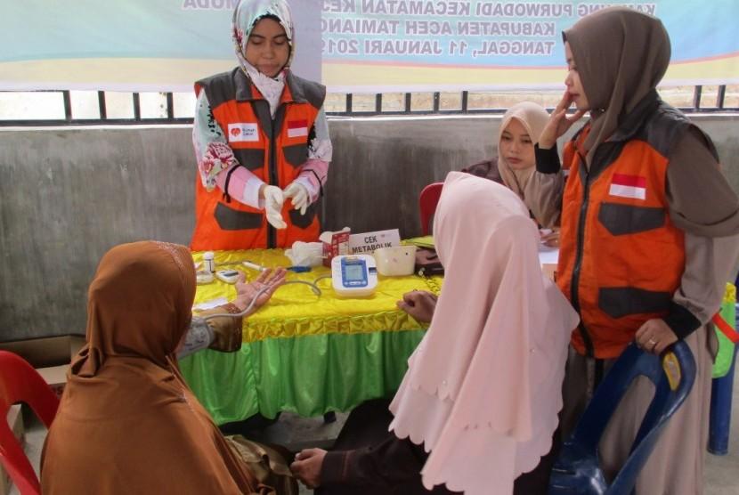 Rumah Zakat mendistribusikan 100 kaleng Superqurban kepada warga di Bali Desa Purwodadi, Kecamatan Kejuruan Muda, Kabupaen Aceh Tamiang, Aceh.