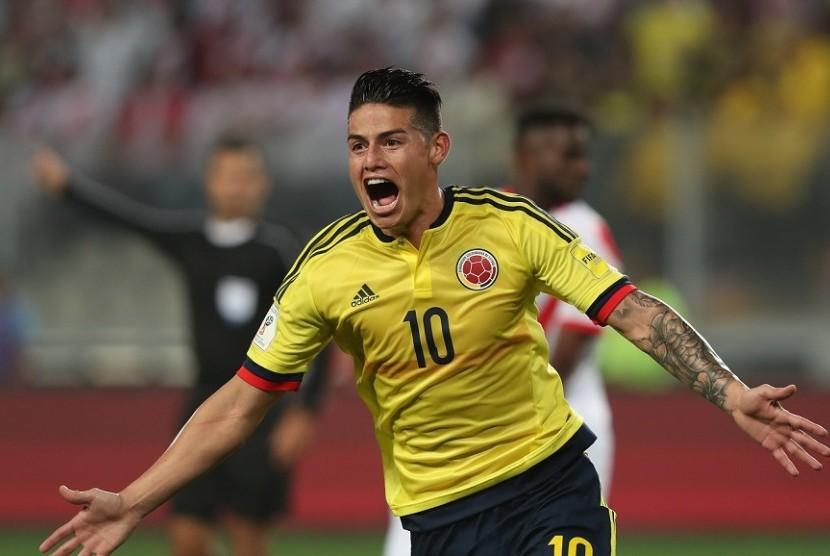 Selebrasi penyerang Kolombia James Rodriguez usai menjebol gawang Peru.