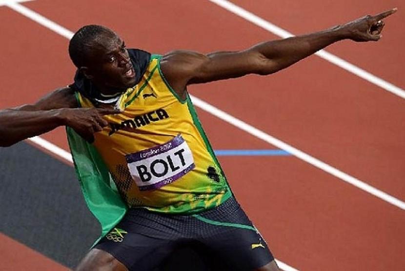 Selebrasi sprinter Jamaika, Usain Bolt  setelah memenangkan medali emas nomor 200 meter.