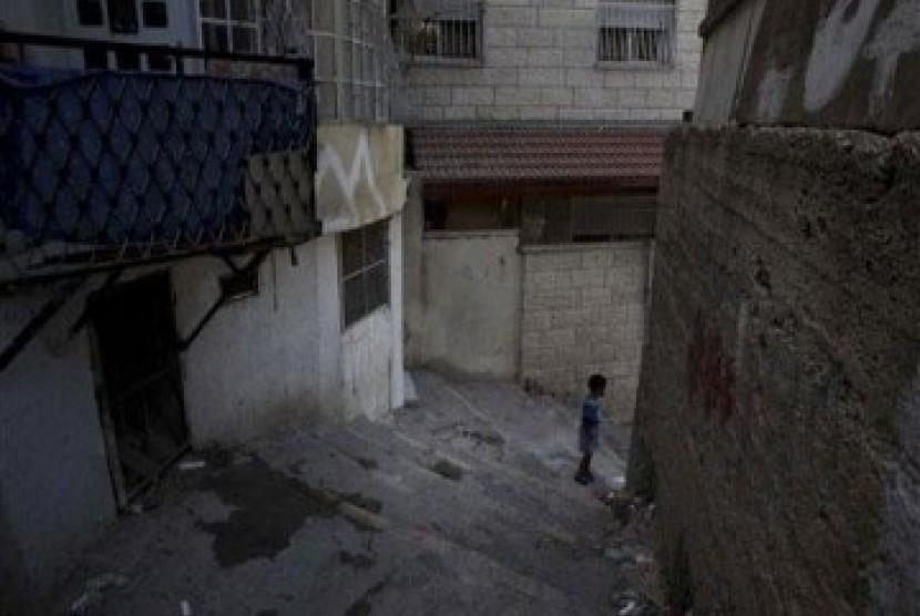 Seorang anak Palestina berada di kawasan Silwan, permukiman warga Palestina di Yerusalem Timur.