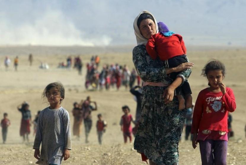 Seorang gadis 9 tahun hamil setelah disandera dan diperkosa oleh militan kelompok Negara Islam. Foto ini merupakan pengungsi dari Irak Yazidi yang dibebaskan ISIS sejak ditawan pada 11 Agustus 2014.