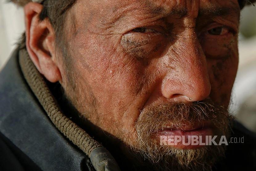 Seorang lelaki Uighur di Daerah Otonomi Xinjiang Uighur, China.