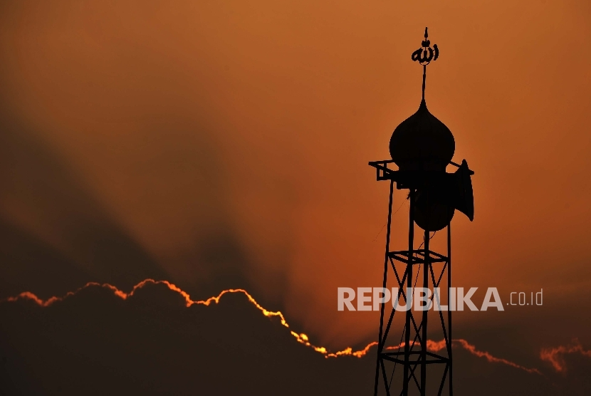 Silhouette of a minaret and mosque's loudspeaker.
