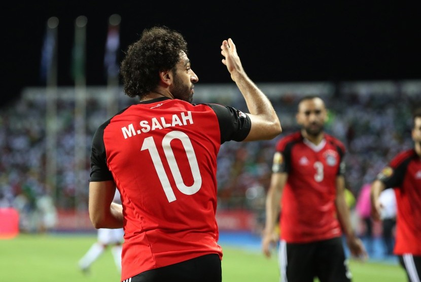 Striker Mesir, Mohamed Salah saat merayakan gol.
