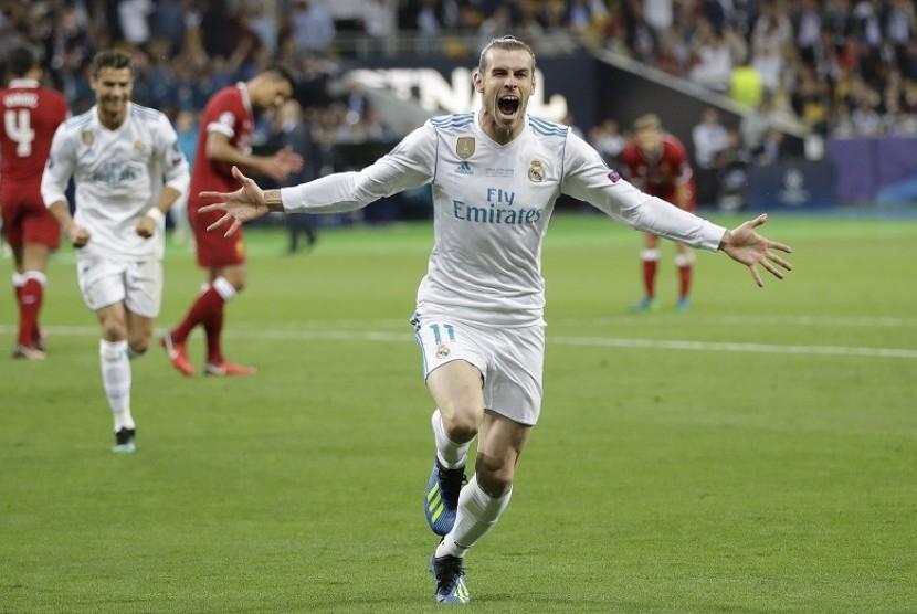 Striker Real Madrid Gareth Bale mengekspresikan kegembiraan usai mencetak gol ke gawang Liverpool di pertandingan final Liga Champions, Ahad (27/5) WIB dini hari di Olimpiyskiy Stadium, Kiev, Ukraina.