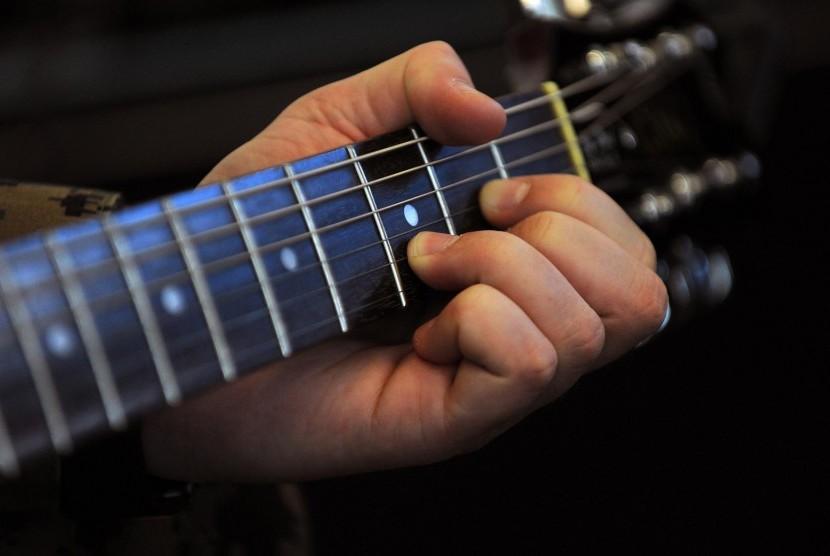 Terapi musik.