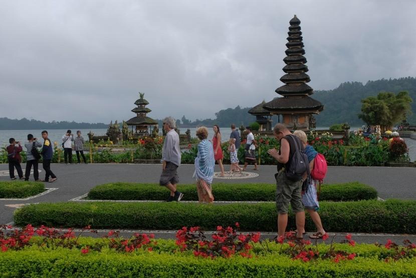 Tourists walk around Ulun Danu Beratan Temple, Tabanan, Bali.