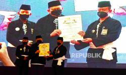 Ketua DPD Dikukuhkan Jadi Warga Kehormatan Utama PSHT