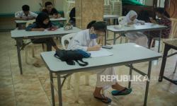 In Picture: Siswa Ikuti Ujian Akhir Semester Gunakan Jaringan Jakwifi