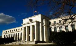 Lonjakan Covid-19, The Fed: Ekonomi AS Makin Lambat