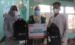 NU Care-Alfamart Salurkan Paket Belajar Yatim Dhuafa