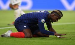 Paul Pogba dari Prancis bereaksi selama pertandingan sepak bola babak penyisihan grup F UEFA EURO 2020 antara Prancis dan Jerman di Munich, Jerman, 15 Juni 2021.