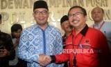 Wali Kota Bandung Ridwan Kamil bersama Ketua Bappilu PDIP Bambang DH usai melakukan pertemuan di Kantor DPP PDIP, Jakarta, Rabu (3/1).