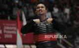 Pesilat Indonesia Abdul Malik (pita merah) meluapkan emosinya seusai bertanding melawan pesilat Vietnam Dinh Tuan Nguyen pada babar penyisihan cabang pencak silat putra kelas B 50-55 kg Asian Games 2018 di Padepokan Pencak Silat TMII, Jakarta, Kamis (23/8).