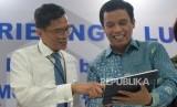 Direktur Utama PT Bank Tabungan Negara (Persero) Tbk. Pahala N.\ Mansury (kiri) bersama Direktur BTN Nixon L. P. Napitupulu (ilustrasi). BTN kembali masuk peringkat Indeks SRI KEHATI
