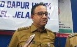 Gubernur DKI Jakarta Anies Baswedan mendatangi lokasi kebakaran di Kelurahan Tomang, Grogol Petamburan, Jakarta Barat, Selasa (22/1).