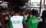 Dompet Dhuafa membantu masyarakat korban banjir di Sentani, Jayapura Papua.
