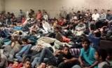 Anak-anak imigran yang ditampung dalam pusat detensi di daerah perbatasan di Amerika Serikat