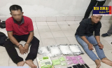 Pelaku beserta barang bukti ekstasi diamankan polisi. (Ilustrasi)