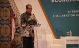 Deputi Gubernur BI, Dody Budi Waluyo berbicara di Forum International Islamic Monetary Economics and Finance Conference (IIMEFC), yang digelar, Kamis (13/12), di Surabaya.