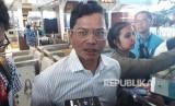 Direktur Utama Garuda Indonesia Pahala N Mansury memberikan keterangan usai melakukan pengecekan operasional penerbangan secara langsung di Bandara Internasional Soekarno-Hatta, Jumat (8/12).