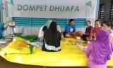 Dompet Dhuafa membantu masyarakat yang terkena banjir di Konawe.