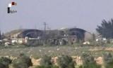 Hanggar pesawat di Pangkalan Udara Shayrat, Suriah yang terbakar dan rusak digempur rudal tomahawk AS pada 7 April 2017.