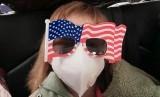 Hermoine Dickey (8) saat dalam perjalanan ke Bandara Internasional Wuhan Tiange untuk penerbangan evakuasi AS.
