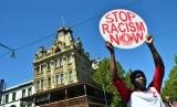 Ilustrasi aksi stop rasisme.