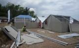 Ilustrasi pembangunan rumah hunian sementara untuk korban gempa di Lombok.