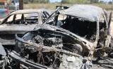 Kendaraan terbakar di distrik bagian selatan Abu Salim, Tripoli, Libya, awal pekan ini, lantaran konflik yang melibatkan dua pemerintahan di negara itu.