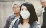 Komisi Kesehatan Nasional Cina akhirnya buka suara soal menyebarnya penyakit pneumonia yang disebabkan virus korona jenis baru di Kota Wuhan (Ilustrasi masyarakat China pakai masker)