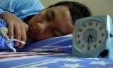 Laki laki tidur.  (ilustrasi)