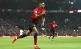 Marcus Rashford merayakan gol kemenangan Manchester United atas Brighton and Hove Albion yang dicetaknya.