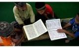 Mata pelajaran agama Islam yang memuat materi sejarah perang dan khilafah dihapus oleh Kemenag. Namun, PGMI menilai pelajaran itu tak menyebabkan radikalisme. Foto: Ilustrasi buku mata pelajaran agama Islam.