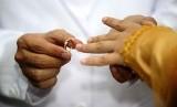 Ada beberapa kondisi dimana perempuan tak boleh dinikahi. Menikah.   (ilustrasi)