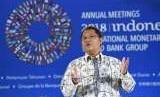 Menkominfo Rudiantara menyampaikan materi saat menjadi pembicara tunggal pada sesi New Economy Talk dalam rangkaian Pertemuan Tahunan IMF - World Bank Group 2018 di Nusa Dua, Bali, Kamis (11/10).