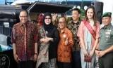 Menteri Koperasi dan UKM AAGN Puspayoga dan Direktur Utama LLP-KUKM Emilia Suhaimi