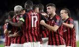 Para pemain AC Milan merayakan gol ke gawang Real Betis.