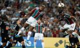 Para pemain Fluminense beraksi saat melawan Corinthians (ilustrasi). Sejumlah pemain Fluminense menolak Liga Brasil kembali bergulir pekan ini.