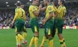 Para pemain Norwich City merayakan gol kemenangan.