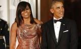 Pasangan Michelle dan Barack Obama. Saat Michelle berulang tahun ke-56, Barack mengunggah pesan manis di Instagram.