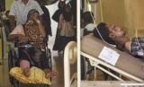 Pasien yang merupakan korban gempa dirawat di lorong RS Umum Kabupaten Pidie, Aceh, Kamis (8/12).