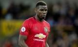 Gelandang Manchester United Paul Pogba. Juventus disebut-sebut bakal mengorbankan tiga nama pemain untuk ditukarkan dengan seorang Pogba.