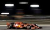 Pebalap Ferrari Sebastian Vettel.
