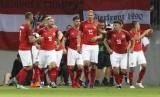 Pemain timnas Austria melakukan selebrasi usai menjebol gawang Jerman dalam laga internasional di Klagenfurt, Austria, Sabtu (2/6).
