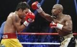 Pertandingan tinju antara Manny Pacquiao melawan Floyd Mayweather, Sabtu (3/5) waktu AS, di Las Vegas.